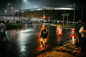 Supporters leave the Arena after a Corinthians match before the World Cup