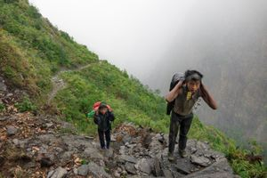 Young boys are on  6 hours trek carry food back to Gumba village, Gumba VDC, Sindhupalchok