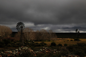Coming storm / Anywhere in the Karoo you can see windmills, used to pump water in this arid and windy region.They seldom stand still like here, as they watch a storm coming over the plateau.