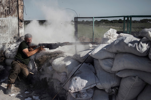 A rebel fires near the Krasnyi Partizan checkpoint