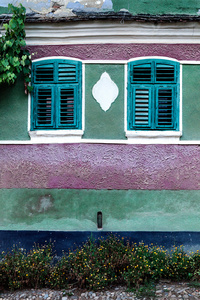 Green & lilac banded wall with baroque style plaque & two windows, Daia 2015