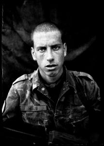 """KABUL PORTRAITS. """"Corporal Freek, engineer"""". Portraits of Dutch ISAF troops in Kabul, Afghanistan. The photos are taken with the antique box camera, borrowed from an Afghan street photographer in Kabul. The exposure time of each photo was 10 seconds."""