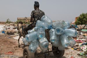 A horse cart loaded with plastic bottles. Waste pickers often rent a horse cart to transport their collected goods.