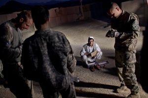 A local Afghan man is detained for questioning by U.S. Army at Combat Operations Post Tangi, in the Tangi Valley, Wardak Province, Afghanistan, on September 12, 2009. © Adam Ferguson