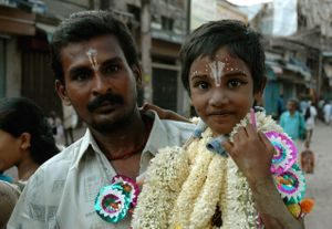Father and son on their way to the Chithirai Thiruvizha festival