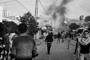 Smoke from a Molotov cocktail rises from Bethlehem Gate. © Will Hilton