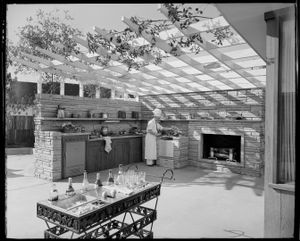 """Outdoor barbecue, Postwar House, Los Angeles, 1946. From the photobook """"Modern Photography and the American Dream"""" © Maynard Parker"""
