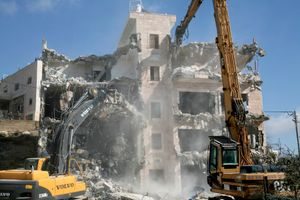 Bulldozers of the Jerusalem municipality demolish a house of a Palestinian family in the East Jerusalem neighbourhood of Silwan, 2007.