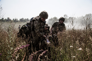 A squad is carrying away a wounded soldier (training).