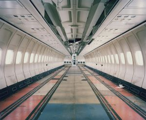"""A Boeing 727 has been stripped of its interiors while its seats undergo maintenance and their covers are replaced. From the series """"The LAB Project"""" © Nick Ballon. Honorable Mention, 2013 LensCulture Exposure Awards"""