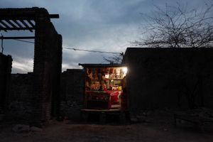 Previously a salt miner, this man now too old, sells snacks and cigarettes from his small shop in the grounds of the salt mine at Warcha.