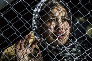December 2015, Greek-Macedonian border near Idomeni. A refugee looks trough the Greek Macedonian border fence from the Macedonian side for her lost family, just as she has crossed the border in one of the chaotic last border crossings. Macedonia closed its border with Greece in december 2015 and again in march 2016, than definitively.