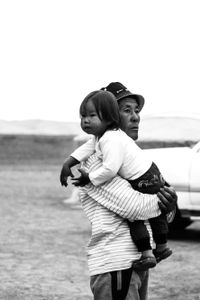 A Father in the Gobi Holds His Son