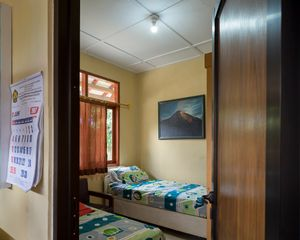 Bedroom in Post Gunung Merapi Kaliurang with Mr.Rasiman's painting