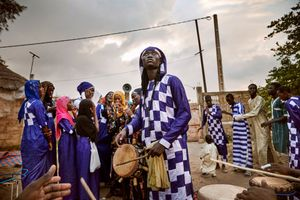 September 30, 2018 – Disciples of the Baye Fall Dahira of Cheikh Seye Baye in Keur Ndiaye Lô perform a religious ceremony that will last til late at night. During the ceremony the disciples, men and women, are drumming, dancing and singing prayers. These chants and rhythms regularly fill the air at night as Baye Fall groups gather and sing their love of god.