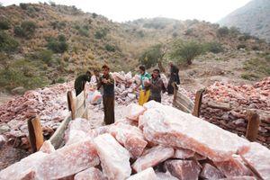 Salt miners loads a trailer with pink rock salt at the Kalabagh salt mine.