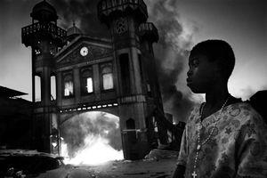 1st Prize General News Single © Riccardo Venturi, Italy, Contrasto. Old Iron Market burns, Port-au-Prince, Haiti, 18 January