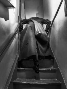Woman ascending staircase