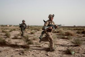 3rd Battalion, 6th Marines come under attack while on patrol as part of a joint NATO operation in Marja District, Helmand Province, Afghanistan on July 27, 2010. U.S. Marines provided a security cordon to an operation conducted by British forces in the neighboring area of operation. © Adam Ferguson