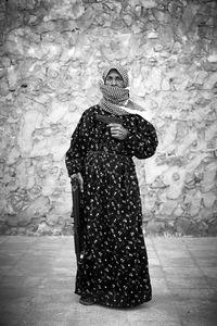 """Om Ahmad, 72 years old, housewife with 3 children: """"My house in Dar'a was destroyed by 2 bombs…I moved to Aleppo with my family, I chose to pick up a weapon and fight the regime."""" © Sebastiano Tomada"""