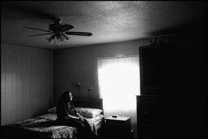 © George Webber - Widow in her bedroom, 2000