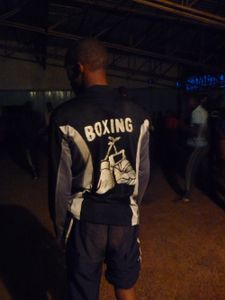 Kaman Nganga, wearing his homemade shirt. He needs to stop training because his calf is injured.