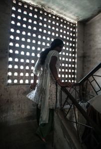 a hijra who lives and works in Thane, Mumbai walks up to the rooms she shares with her hijra group  © Alison McCauley