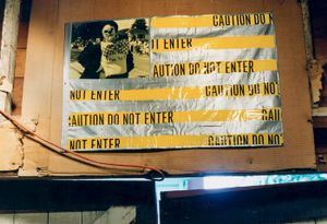 """""""Flag (Yellow State)"""" (dyed resin-coated photograph, caution tape, duct tape, grommets)"""