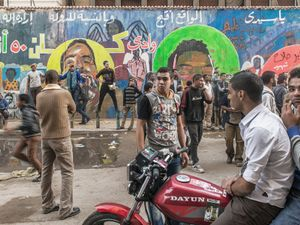Mohamed Mahmoud street where hundreds of protesters were killed during the days of the uprising two years ago. The wall includes pictures of many of the young people who were killed. © Domenico D'Alessandro