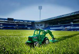 The stadium grass is getting cut