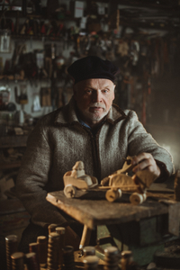 Traditional crafts. Portrait of the Toy Maker
