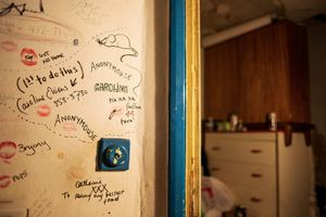 Lipstick prints and writings on the wall remain as traces of a tenant that used to rent one of George's rooms.  © Corinna Kern