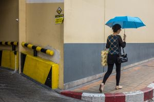Woman with blue umbrella, Singapore