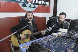 Singer Tolga Kurdoğlu and his friend Erdinç hosting their weekly program on Laz culture at the studio of Radyo Arhavim.