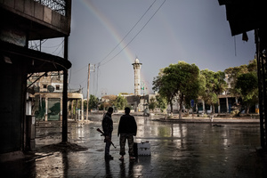 After heavy clashes, a rainbow appears in the sky.