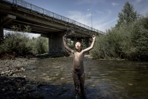 10-year-old Khulan playing in the polluted Tuul river.
