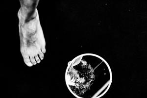 A foot, a face, a mirror