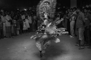 A chhau dancer, on a vigorous move