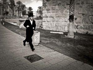 Jewish man running outside the walled city, Jerusalem