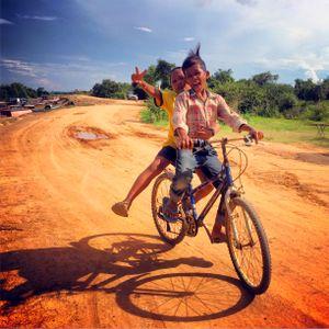 Kids on bike Kompong Phluk
