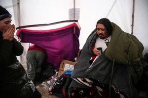 Toby Joseph sits after being attended by medics for nausea and heavy chest symptoms during the first days of harsh winter at the Rosebud Camp at the Standing Rock Indian Reservation in Cannon Ball, North Dakota in December 2016. Joseph was evacuated out of camp shortly after to a safer area until the blizzard was to calm.