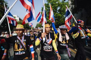 Protesters march in an anti-government street demonstration in Bangkok.