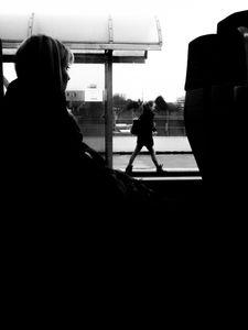 A girl watching a walking girl