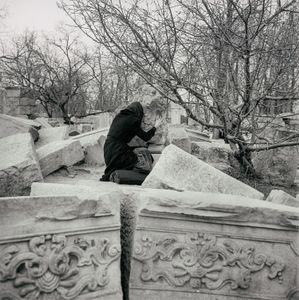 Yuan Ming Yuan 4, Beijing, China Woman crying at fallen lion sculpture