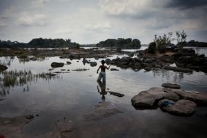 A boy fishes in the river in front of the Arara indigenous territory. The indigenous communities are still living following very traditional lifestyles and their own existance depends on the river. © Dario Bosio/Parallelozero