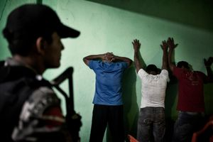 Police checking on suspects in a brothel of Altamira. Due to huge immigration rate Altamira is experiencing a crime wave that the police is struggling to fight. Drug traffic, prostitution rate, rapes and robberies increased since the construction of Belo Monte began. © Dario Bosio/Parallelozero