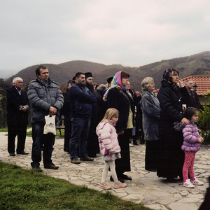 Banjska, Kosovo.  February 2014. Faithful in front of the  Monastery of Banjska.
