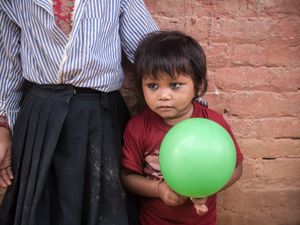 Shy kid with balloon