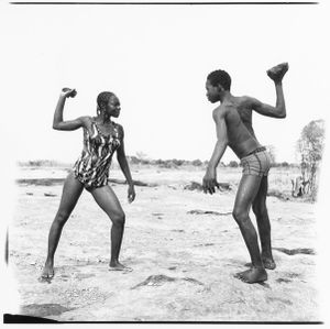 © Malick Sidibé, Friends fighting with stones, 1976, gelatin silver print, 50 x 60 cm. Courtesy of Fifty One Fine Art Photography.