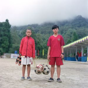 """School girls before football practice, from the series """"Homebodies""""."""